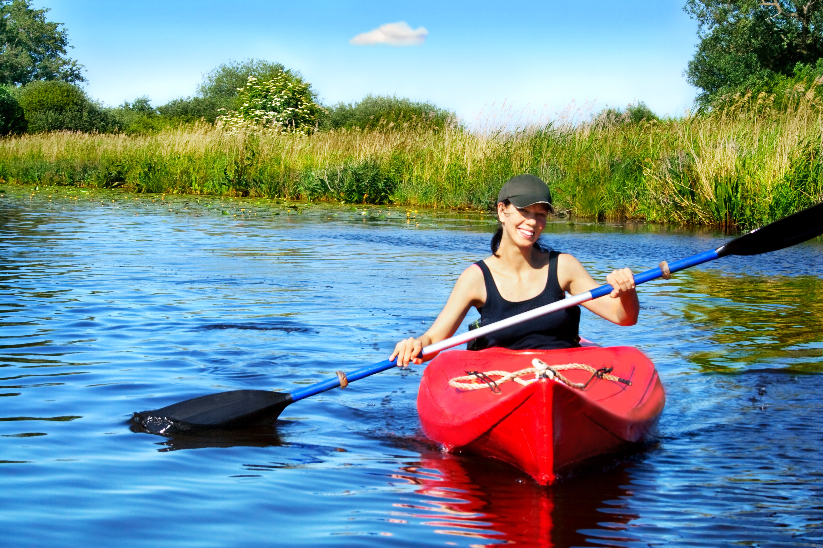 bigstock-Girl-with-paddle-and-kayak-on--35480015